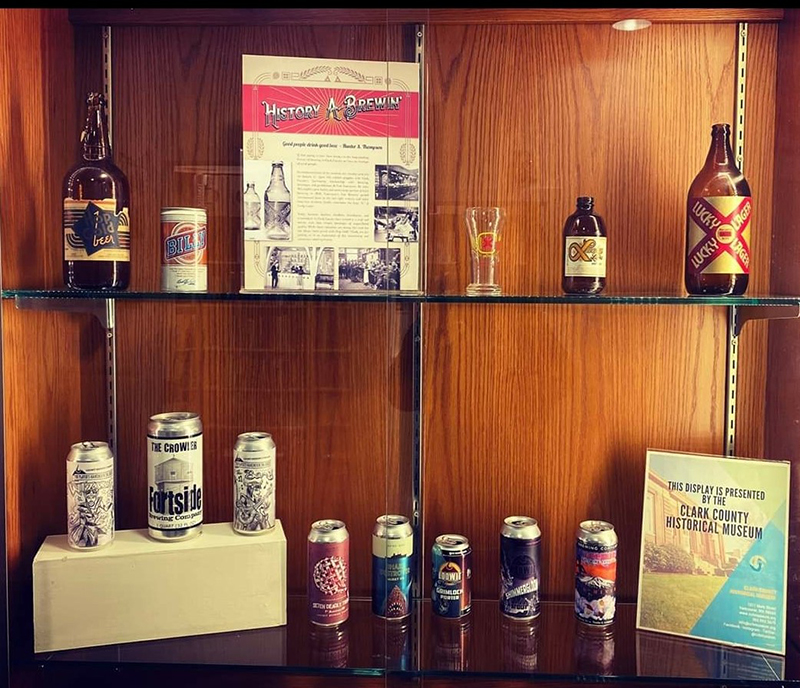 Two shelf display of beer cans and bottles with signage, Clark County Historical Museum